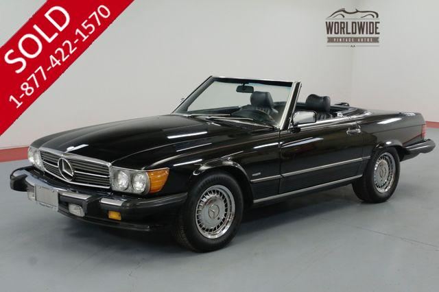 1986 MERCEDES BENZ 560 SERIES TRIPLE BLACK! IMMACULATE. LOW MILES. COLD A/C.